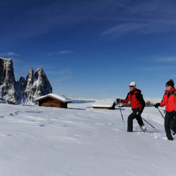 Snowshoe hiking on Alpe di Siusi with Sciliar