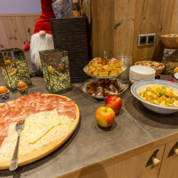 Breakfast buffet with speck, cheese and much mor on a farm holiday in Castelrotto
